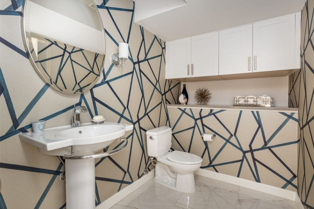 Bathroom with geometric designs on the wall and modern decor